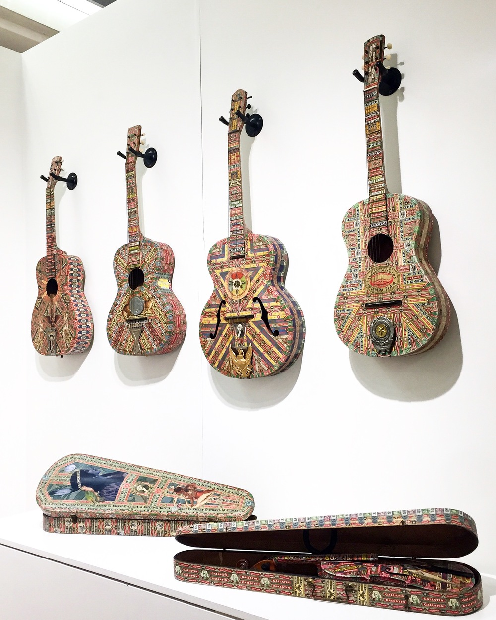 I  ncredible cigar band collaged musical instruments by Cuban-American artist Felipe Jesus Consalvos presented by   Fleisher Ollman  .