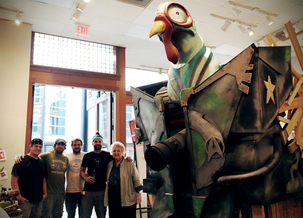 From left to right: Brian Somerville, Sean Perdue, Trey Gossett, Jason York, Owner Anne Brown, with Tank Chicken