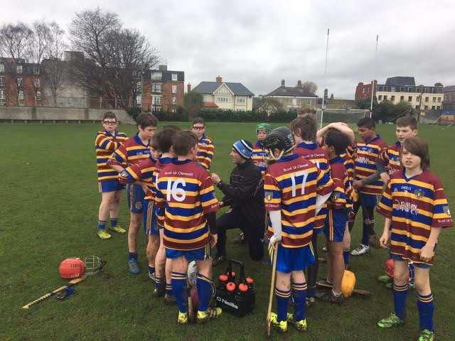 U13 Boys Hurling Manager Cathal O'Connell offers his team some instruction.
