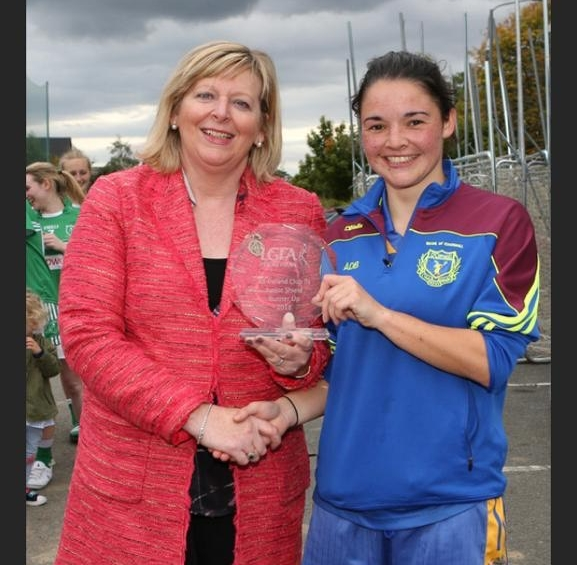 Captain Aoife DeBurca accepting the runners-up shield on behalf of her team