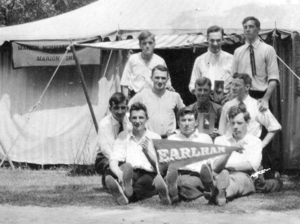 Paul at Earlham College, in center holding pennant