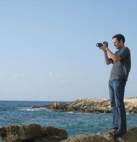 Christopher Sakr, filming the Mediterranean on the coast of Northern Lebanon.  -Photo by Claude Sakr