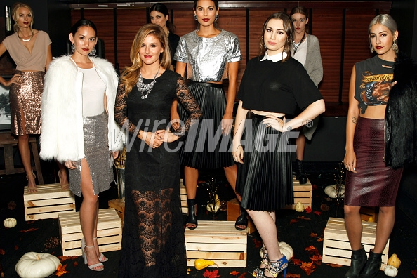 Sophie and Hilary Hahn of The Style Club stand with some of the models