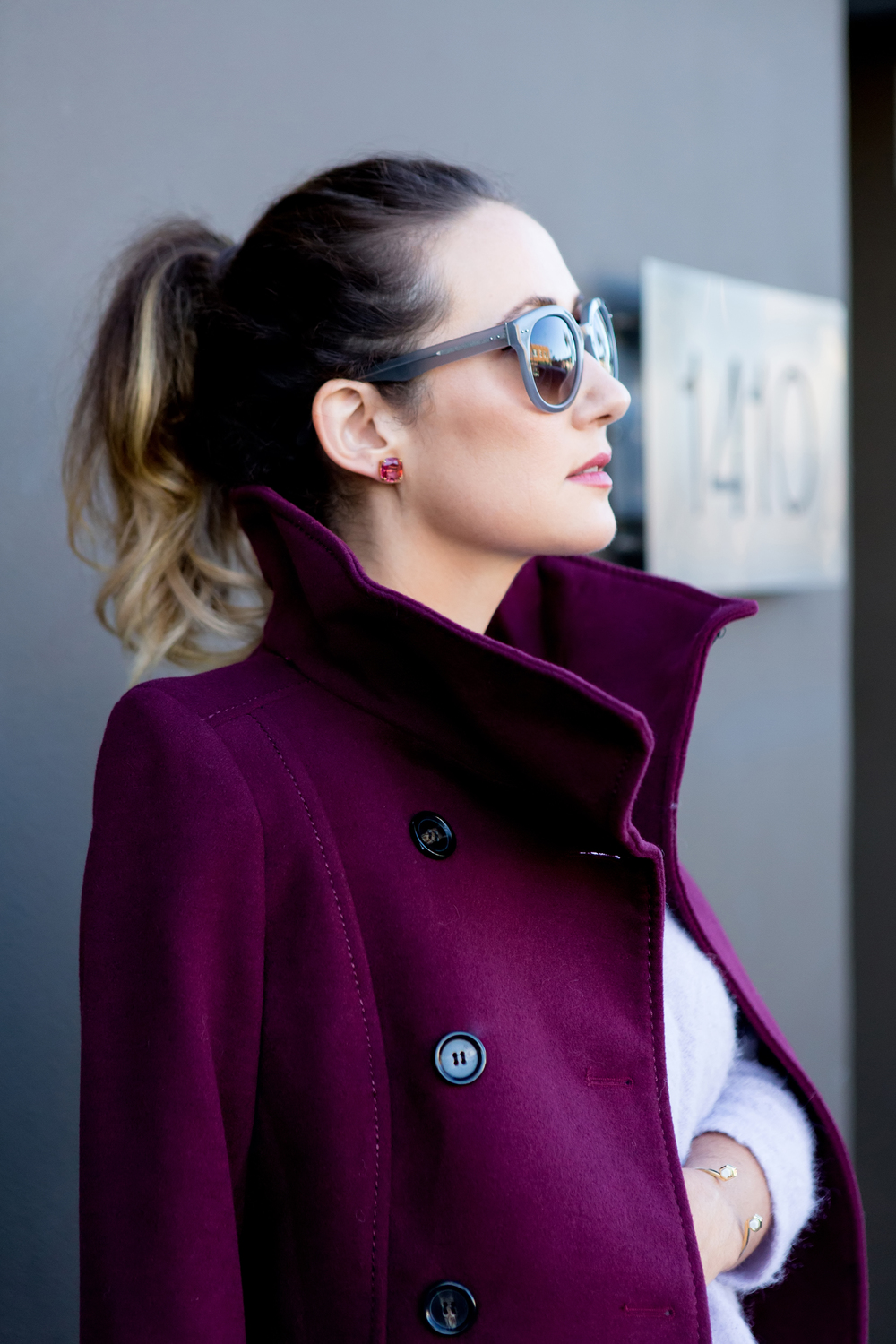 Coat, H and M. Sunglasses, Linda Farrow Luxe. Earrings Kate Spade NY. Chrysalis Cuff, House of Harlow 1960