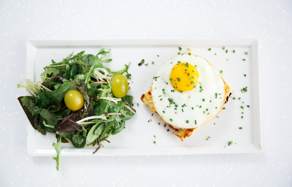 The Croque Madame with mixed greens at Le Petit Paris is a must try.