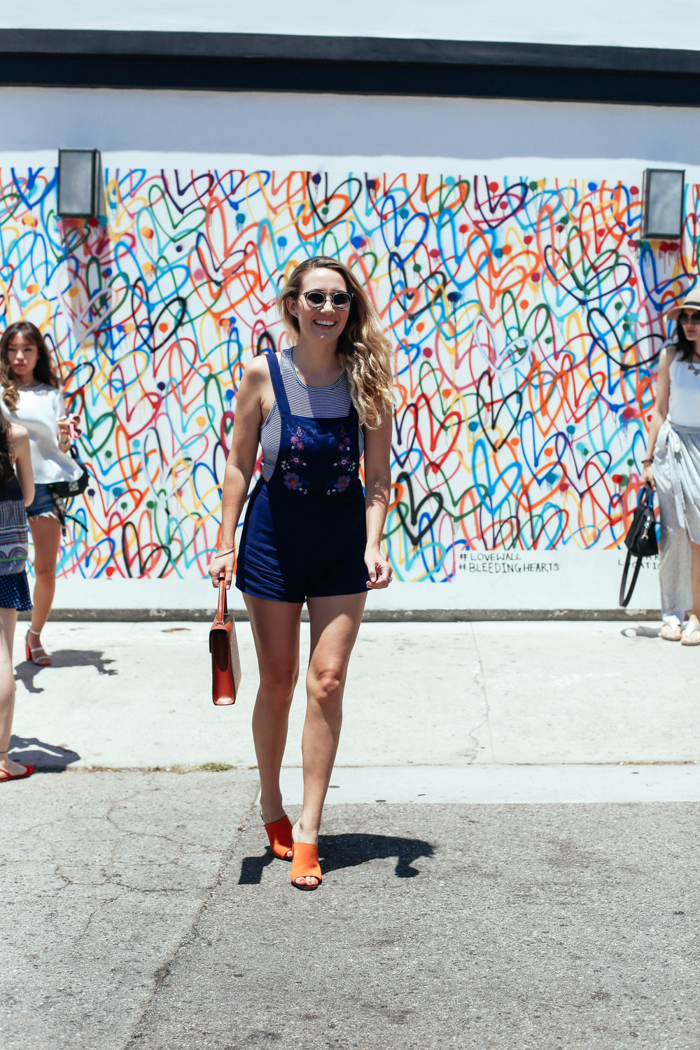 Me literally LOLing whilst trying to get a snap amongst stubborn tourists on the Love Wall, off of Abbot Kinney in Venice Beach. Not pictured: my friends laughing at me.