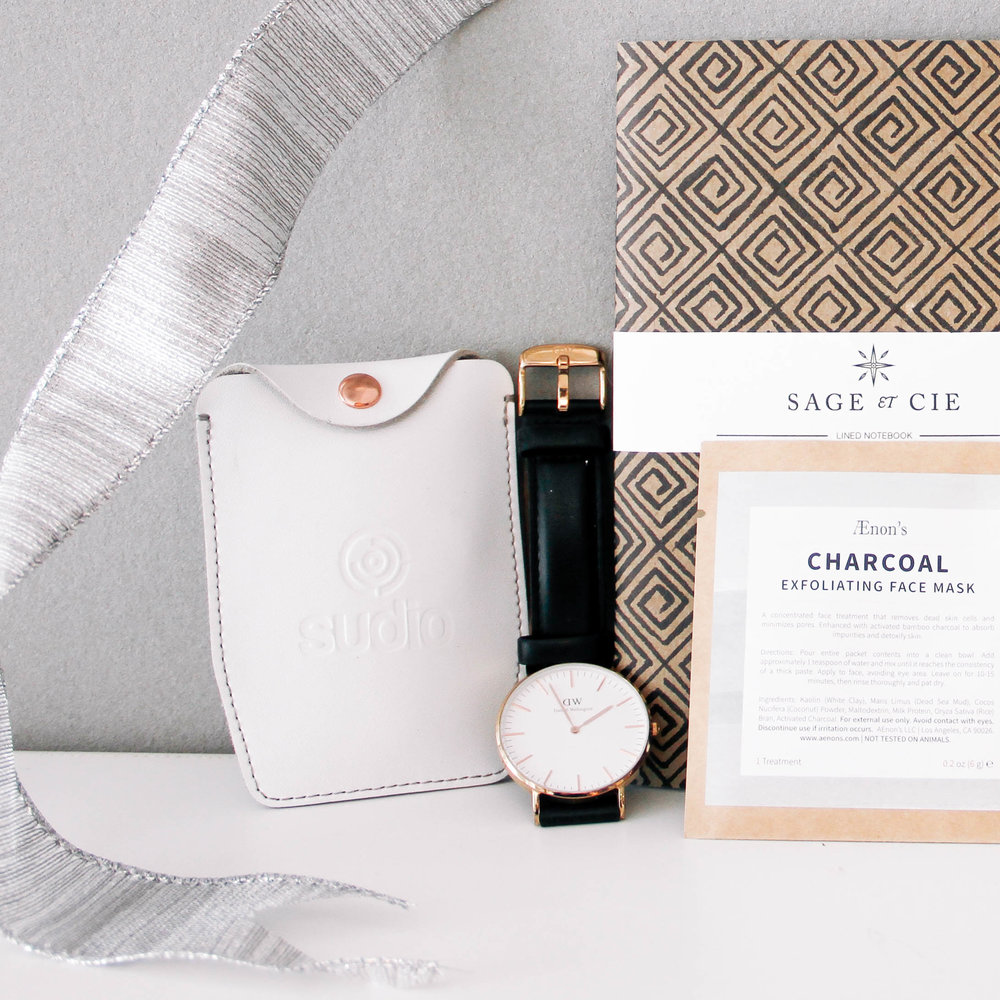 Sudio Sweden Vasa Bla headphones, Daniel Wellington classic Sheffield watch, $199, Aenon charcoal face mask, $6 and Sage et Cie recycled paper notebook, $12 both via ShopWantList.