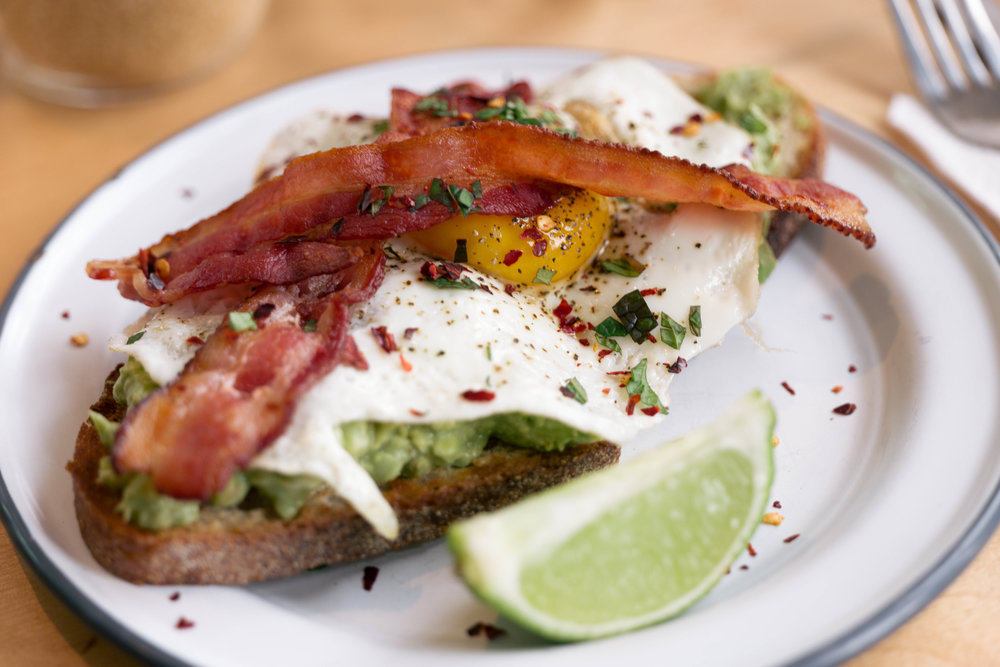 The Avocado Toast with fried egg and bacon at Sweatshop NYC - amazing for post-birthday celebration hangovers!