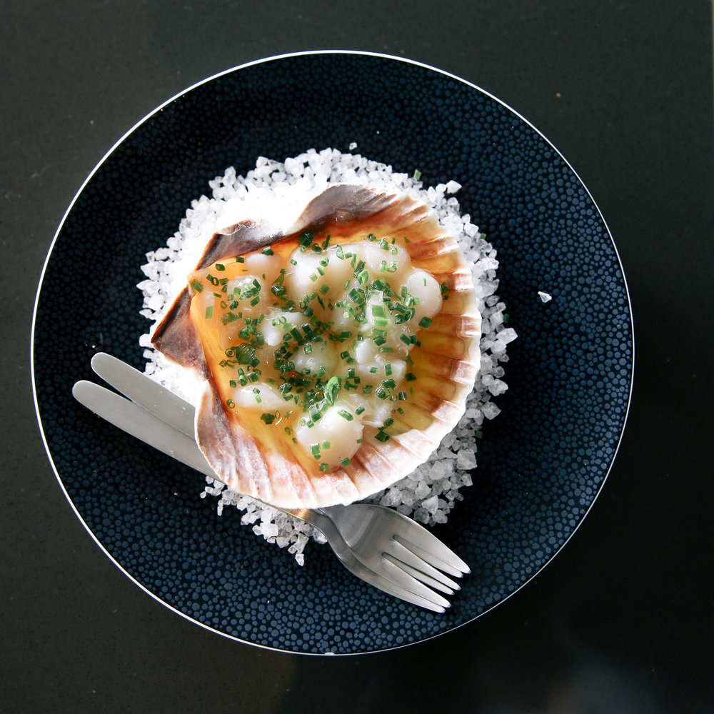 Raw scallops with butter, chives, lemon, and sea salt at Bottlefish Brentwood