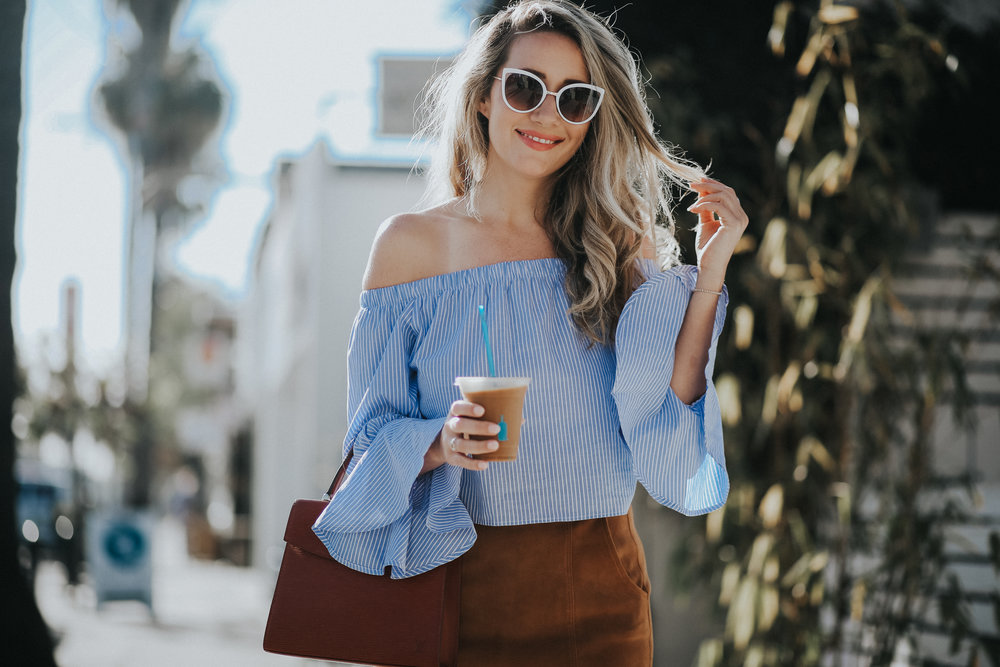 Blue pinstripe statement sleeve blouse street style via The Style Sauce Blog