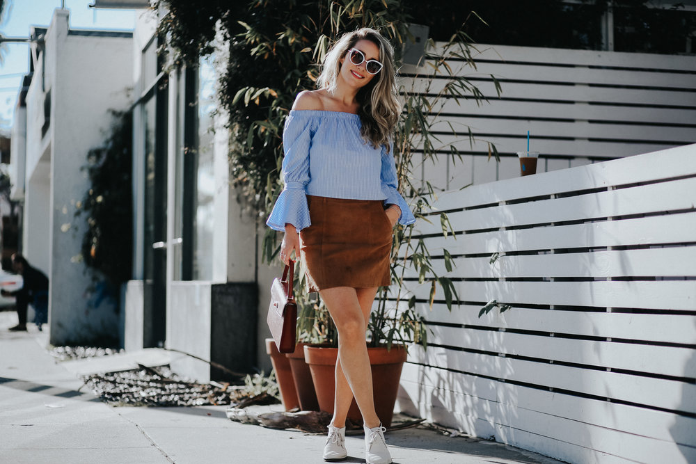 Street style blue striped statement top with flared sleeves and tan suede skirt from AG Jeans // Spring Style via The Style Sauce blog