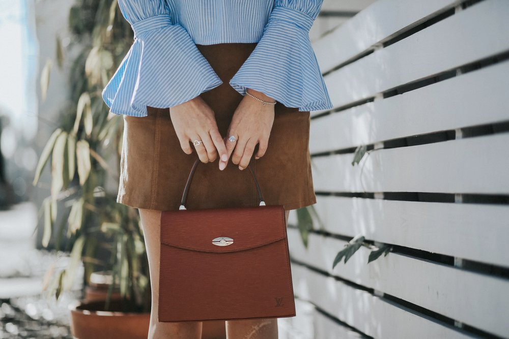 Details striped statement top with Louis Vuitton Malesherbes vintage top handle bag and brown suede skirt // The Style Sauce Blog