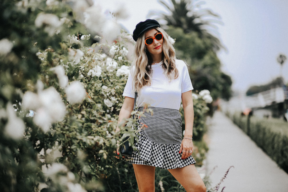 The Venice Canals are always a popular tourist and photo shoot location. Here I'm wearing a  gingham skirt ,  orange sunglasses , and  page boy hat . Photo via  Stefanie Marie .