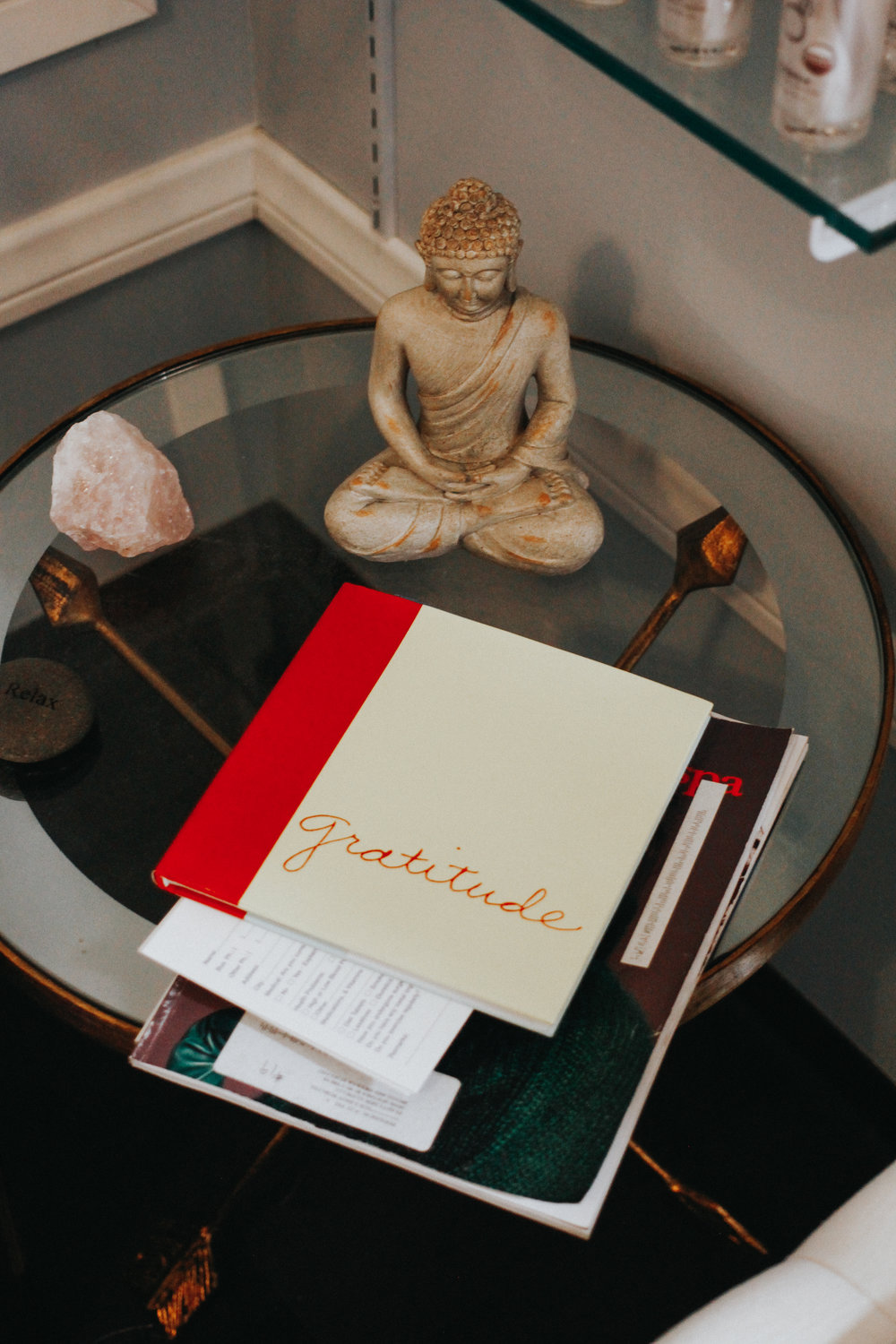 Books and buddhas make Gayle's facial room feel zen and relaxed.