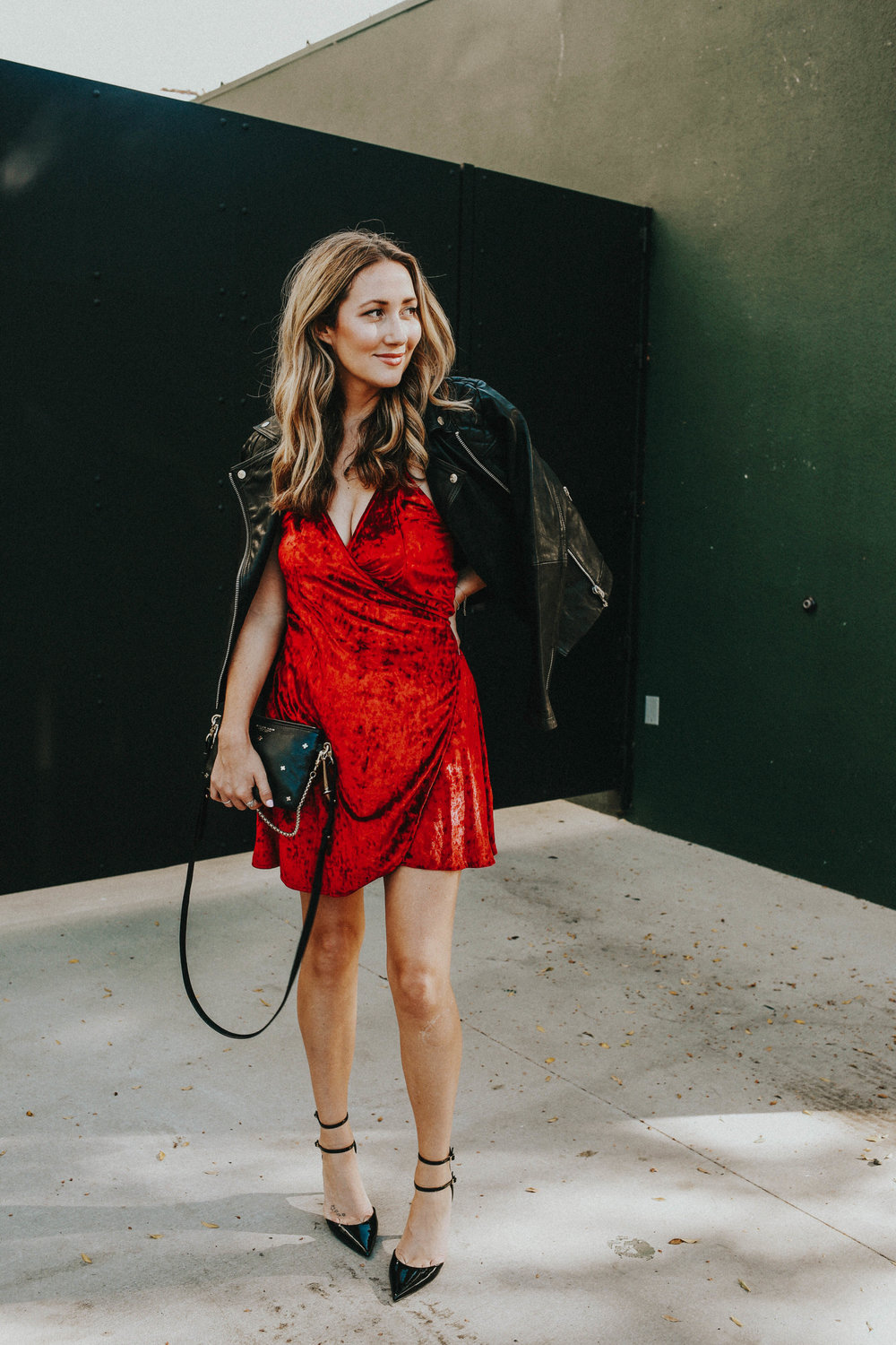the style sauce fashion blog // red crushed velvet wrap dress // leather jacket // how to style a red dress // date night look