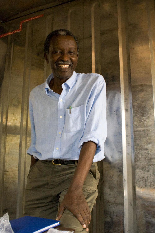 The artist, Sanaa Gateja, smiles in his studio at the arts trust in Kampala.