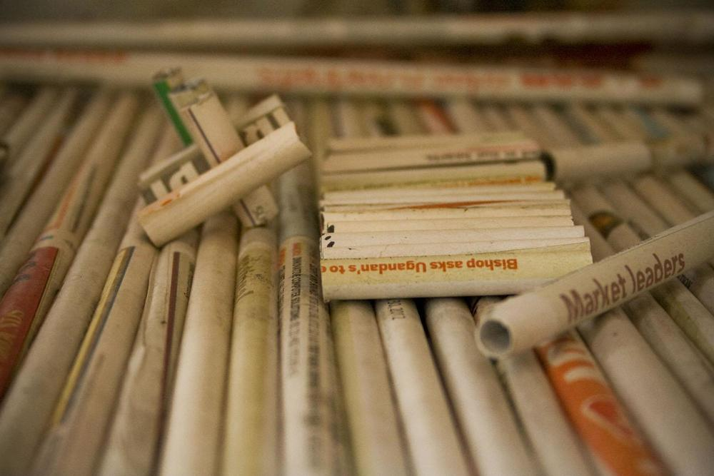 Newspaper is rolled into mini tubes that will eventually become a modern art relief object, dyed and treated so the newspaper doesn't age. Another one of Sanaa's innovative techniques and a great takeaway idea for projects at home!
