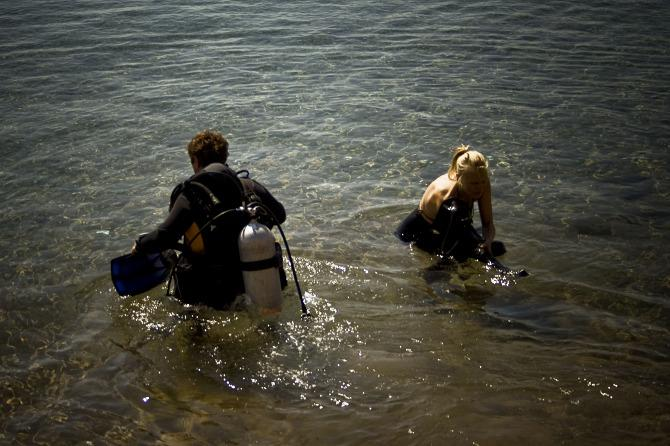 Free-diver Nanna and her scuba diving buddy prepare to head beneath the surface.