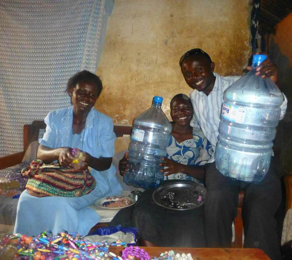 Ruganzu delivers water container to a local family and explains the importance of boiling the water to make it safe. Photo courtesy of Ruganzu.