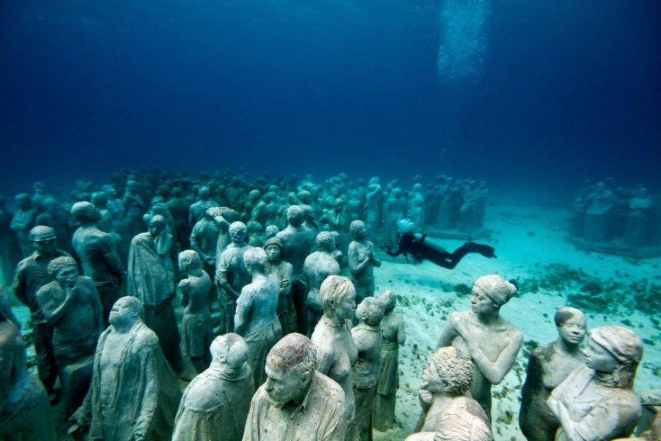 Taylor's The Silent Evolution shows us what is possible when art, water, and environmental mindfulness connect through human creativity and passion. Photo courtesy of Jason deCaires Taylor/www.underwatersculpture.com.