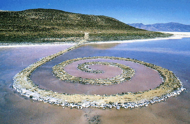 Eventually this entire mass of structured land will disappear back from where it came. As the water rises to hide the spiral, then lowers back down to reveal it, only nature knows the eventual shape this piece of art will take. Photo courtesy of www.search.xhibitor.org.