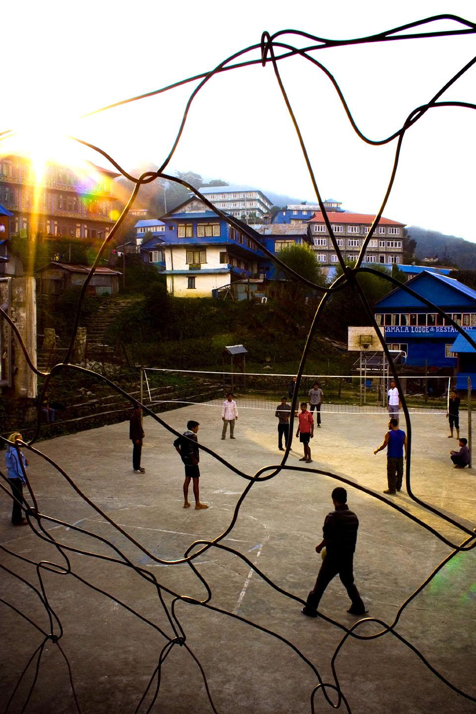 Chances are that these kids, playing on a basketball court in Nepal, aren't experiencing the same privileged lifestyle that many kids in North America are born into. Photo by Kimberly Bryant.