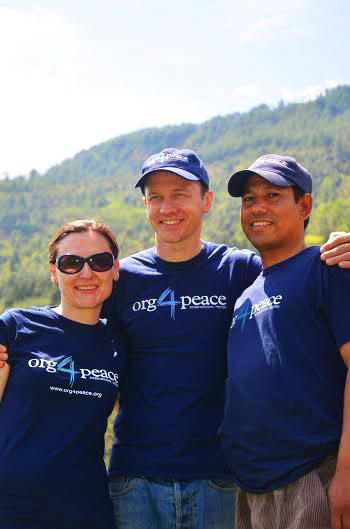 Scott Morgan (middle) stands with his Org4Peace colleagues, who work on the charity during their free time. Since they hold full-time jobs, don't pay for advertisements, and work virtually, all of the money donated to Org4Peace goes directly into supporting the families and other positive projects. Photo courtesy of Scott Morgan.