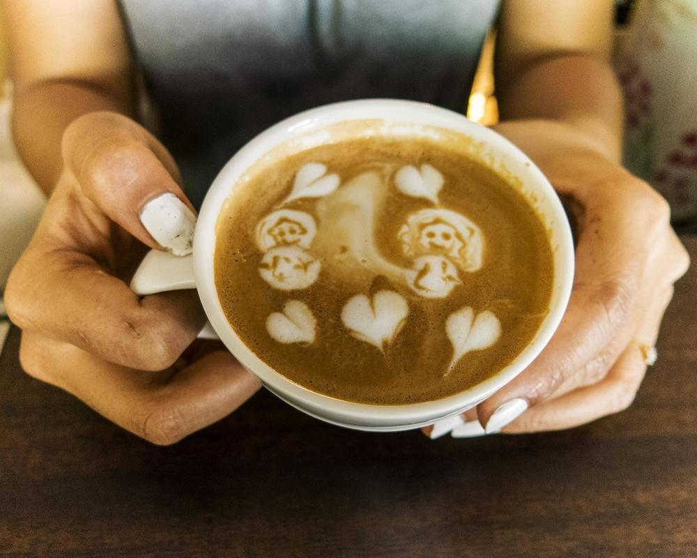 Patty, a beautiful latte artist, makes a creation that depicts her and her best friend. Totally charming, that. Photo by Kimberly Bryant.