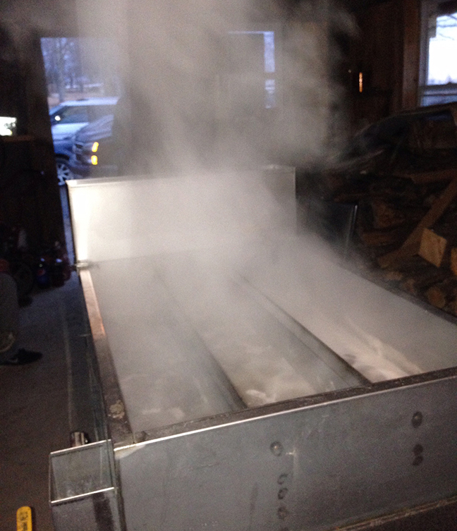 Boiling down maple sap in the Chadwick's on-sight facility.