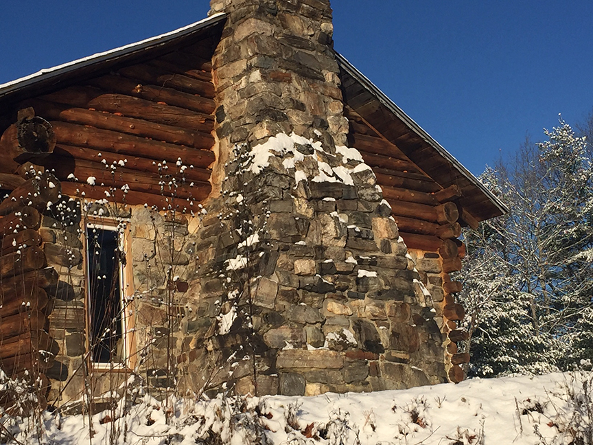 It's cold but clear in this shot of Larry Chadwick's hand built cabin.  The fireplace and chimney was constructed from rocks found on Larry's property while building the main structure.