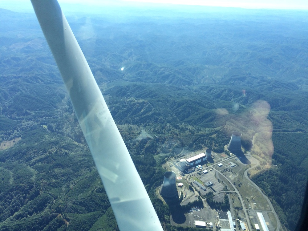 Satsop Cooling a Towers and the Author's club hand in the reflection...