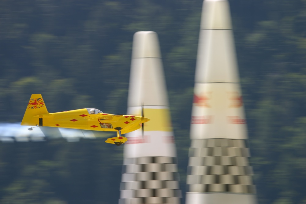 Aerobatic plane crossing finish line at the air races