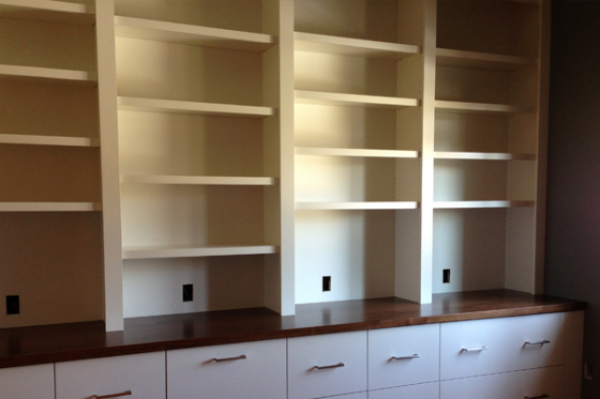 In progress: shelving with walnut counter, and outlets at each section