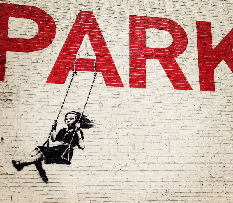 "I took this photo in a parking lot in the LA fashion district. Love how ""Parking"" becomes  ""Park"" for the child on the swing."