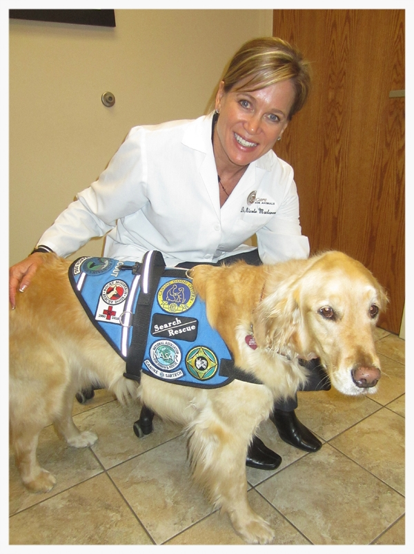 Dr. Nicole MacLaren with Search and Rescue Dog Gunny