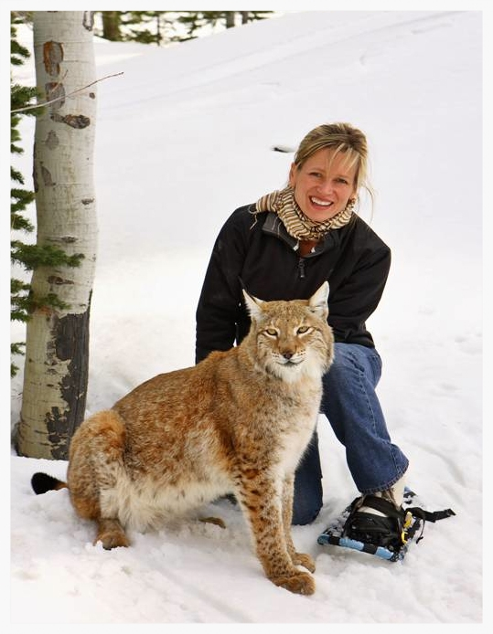 Dr. Nicole MacLaren with an Asian Lynx, his first time on snow, at Deer Valley, Utah