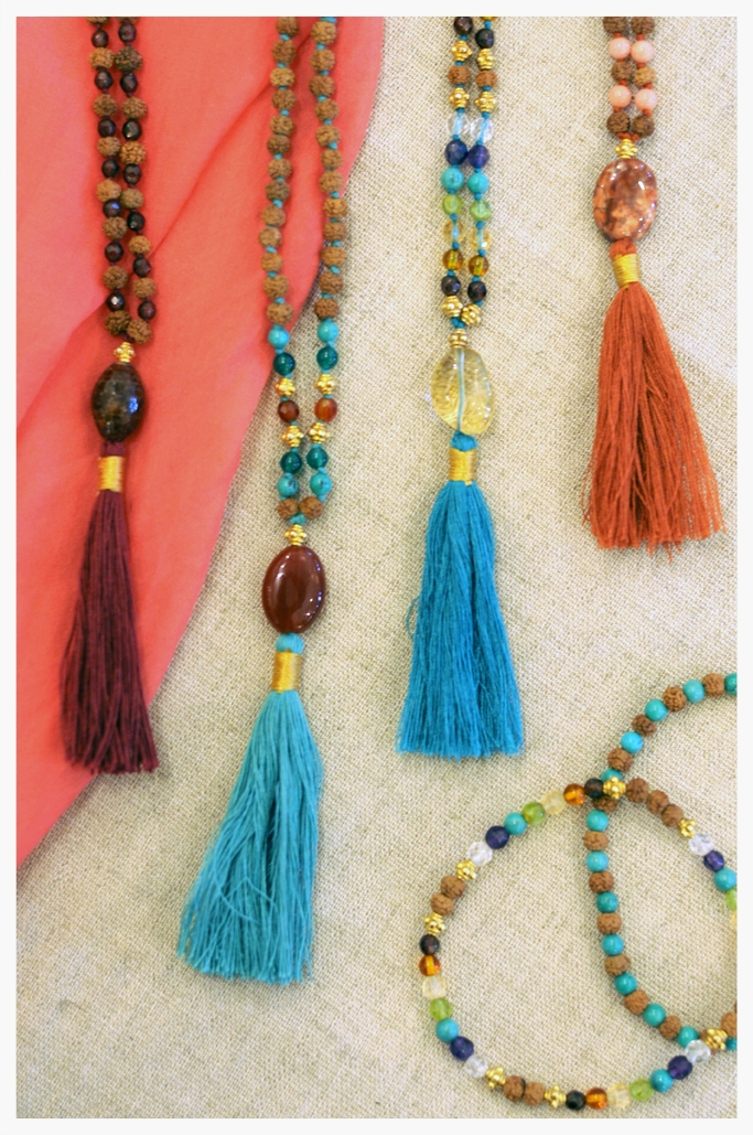 left to right: Mala necklaces and bracelets: Rudraksha, raw cut rubies and sapphires; Rudraksha agate and turquoise; Rudraksha and 22k gold plated silver beads, citrine, amethyst, turquoise, garnet, crystal quartz, peridot; Rudraksha and pink coral; bracelets in similar stones