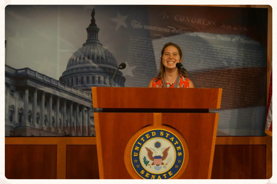 Lucy speaking to the Senate in Washington, DC.