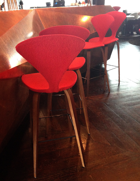 I ran across these lovely Cherner bar stools, covered in red, in a stylish  restaurant in London