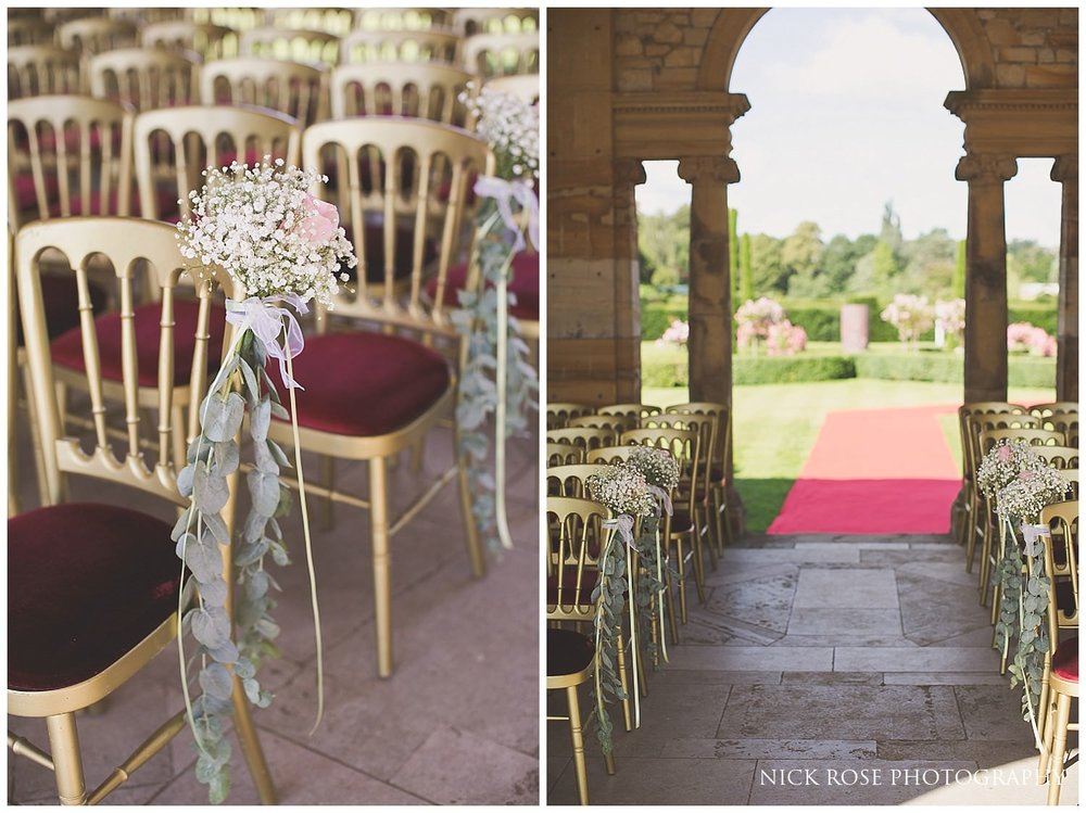 Red carpet and matching gold and red chairs for a Hever Castle civil wedding in Kent