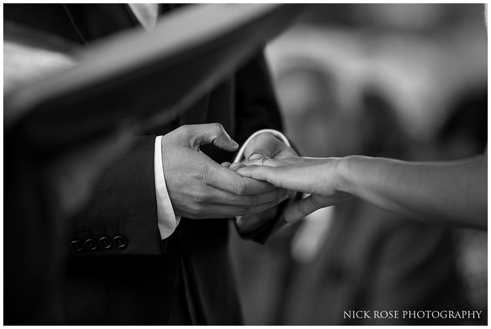 Bride and groom exchanging rings at a Hever Castle Wedding ceremony