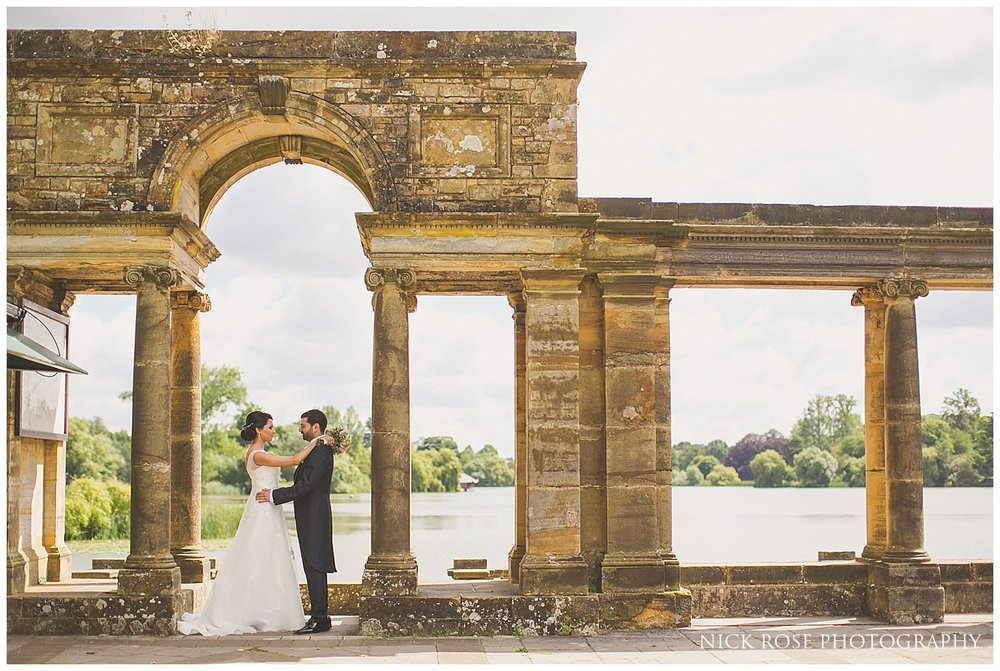 Bride and groom wedding portrait photograph by the lake at Hever Castle