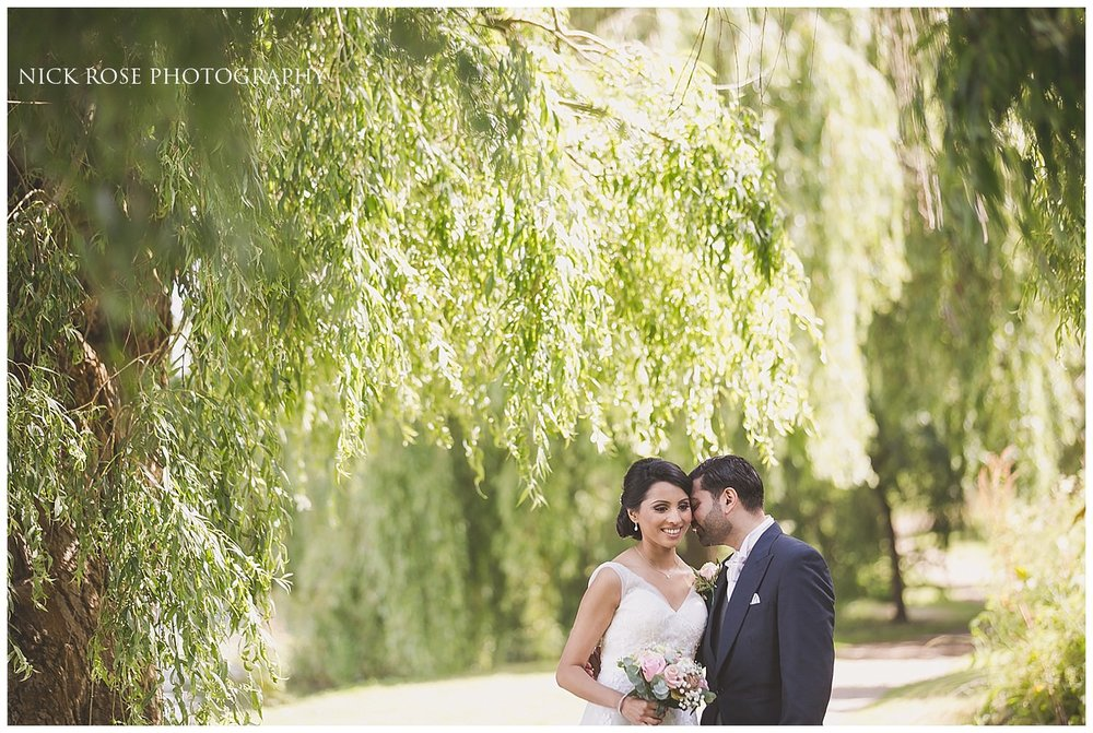 Wedding photograph under a willow tree at Hever Castle Kent