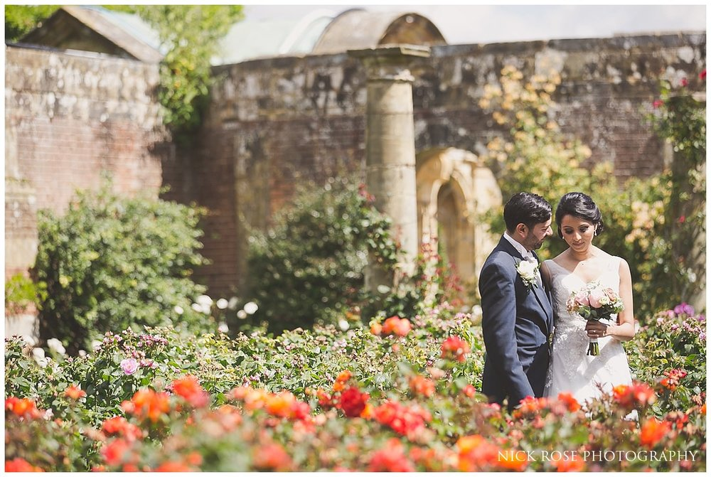 Bride and groom wedding photography portrait in the gardens at Hever Castle Kent