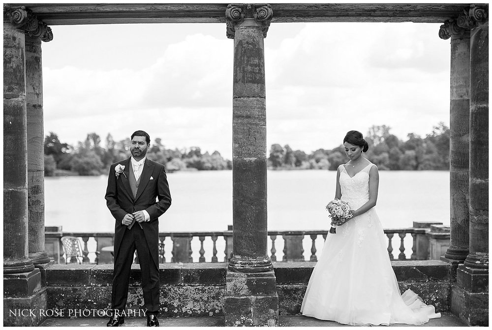 Bride and groom stading by the lake at Hever Castle Kent