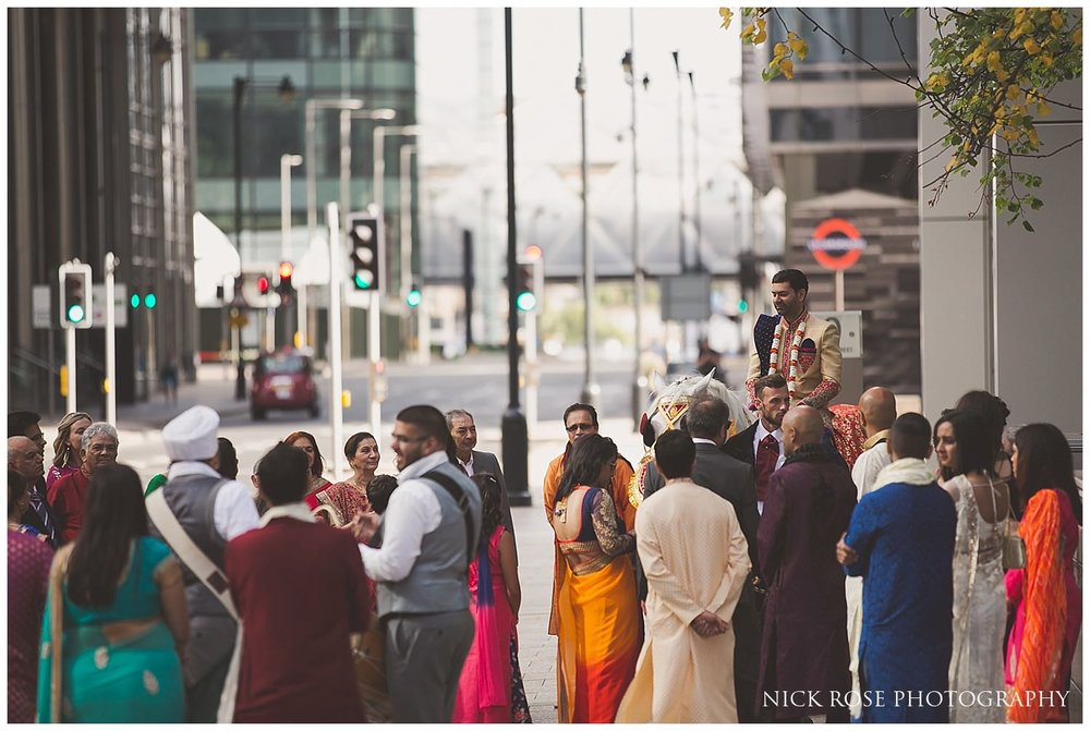 Hindu wedding Baraat with horse entrance at the East Wintergarden in London's Canary Wharf