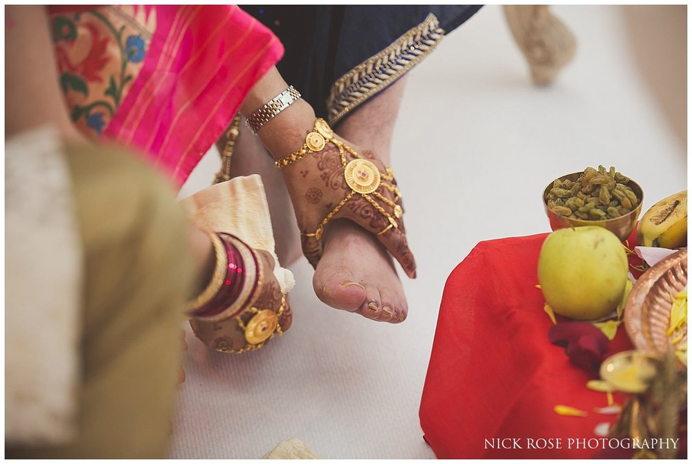 Indian groom having his feet washed before a Hindu wedding in London
