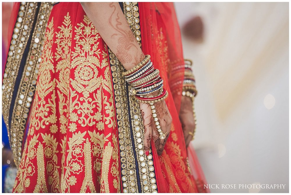 Brides hands with mehndi and bangles during a London Hindu wedding ceremony