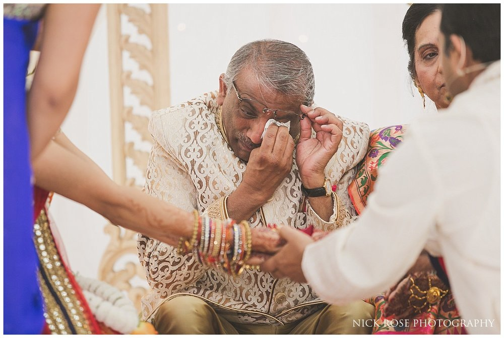 Brides father shedding a tear during an East Wintergarden Hindu wedding ceremony in Canary Wharf London