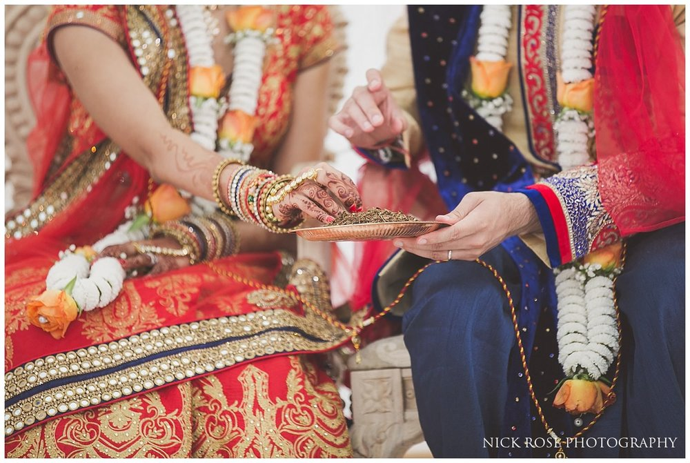 Asian Hindu wedding rituals taking place in the East Wintergarden at London's Canary Wharf
